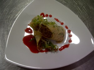 Peking duck in a coriander crepe