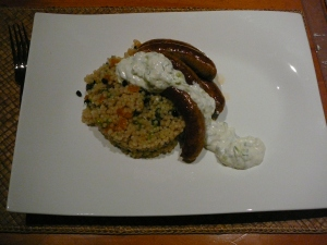 Couscous, merguez sausages, and raita/tzatziki