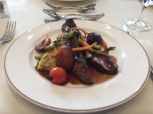 Roast duck breast, roesti and seasonal vegetables