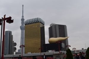 About to pass under Asakusabashi looking to Asahi Tower and Tokyo Skytree