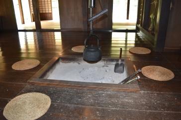 Irori with blackened bamboo chain cover
